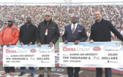 Representatives of Coors Light present $10,000 scholarship checks to Alabama State University and Alabama A&M University during the 72nd Magic City Classic. Coors Light has supported HBCU classics for nearly three decades, and this year will award $120,000 in scholarships, benefitting juniors and seniors 21 years of age and older, attending select HBCUs. Pictured above (L/R): Melvin Reeves, Michael Maddox, William Harris, Andrew Hugine Jr., and Brian Sykes. (Photo courtesy of MillerCoors/Lord David Nelson)
