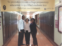 Holy Family Cristo Rey honor roll seniors Elijah Brown, left, and Khayla Jones with college counselor Pamela Cowan