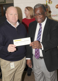 Mike Donn of Dollar General with Bessemer Middle School Principal  Albert Sols.