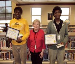 Joel McCandless, Senior English instructor Antoinette Hartley, and Jabriel Jones