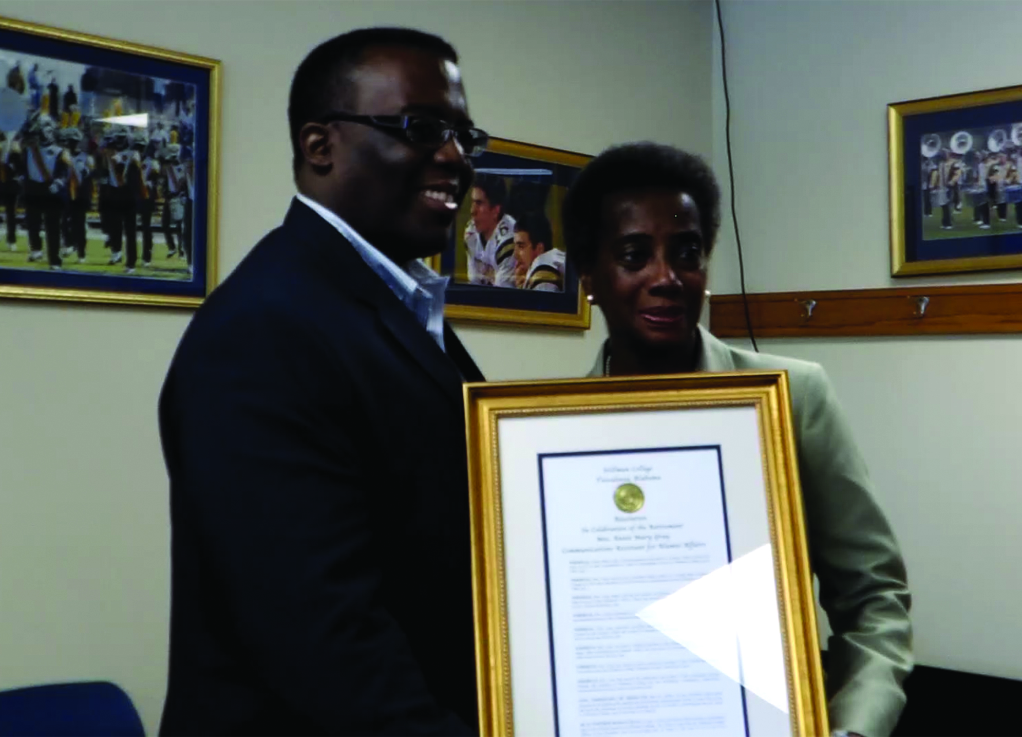 Dr. Peter Millet presented Ms. Gray with a resolution.