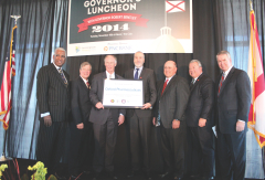 2014 Governor's Luncheon: (from left to right) Birmingham Mayor William Bell; Jefferson County Commission President Jimmie Stephens; Governor Robert Bentley; John Hoffmire, chairman of Oxford Pharmaceuticals; Grayson Hall, CEO of Regions Financial Corp.; Alabama Secretary of Commerce Greg Canfield; and Brian Hilson, president and CEO of the Birmingham Business Alliance