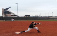 Newcomer Carly Evans stretches out at first base for a throw from right field in practice.