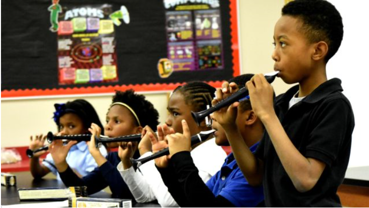 Robinson Elementary School, teaching third-graders to play the flutophone (Solomon Crenshaw Jr. Photos: Special to the Times)