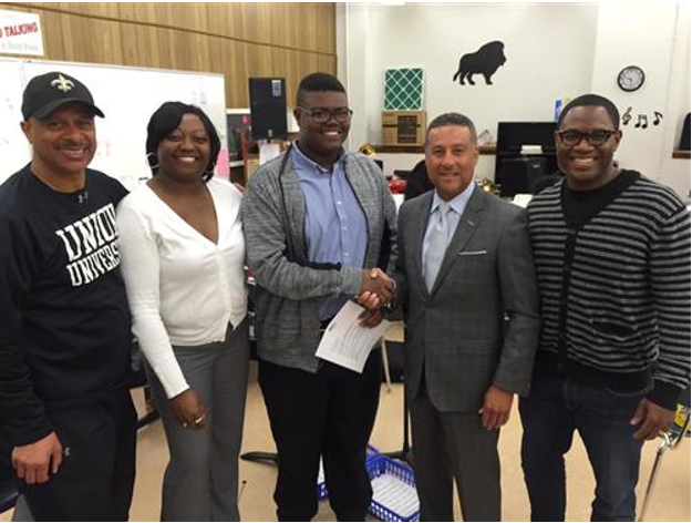 Phillips Academy seventh grader Jaeden Henderson, (center) meets with Summit Media Entertainment President Chuck Faush at Phillips Academy.  Also pictured, from left, are Jaeden's music teacher, Joseph Smith III; Sonjanika Henderson, Jaeden's mother; and Grammy-nominated performer Alvin Garrett. (Photo by Chanda Temple) ​