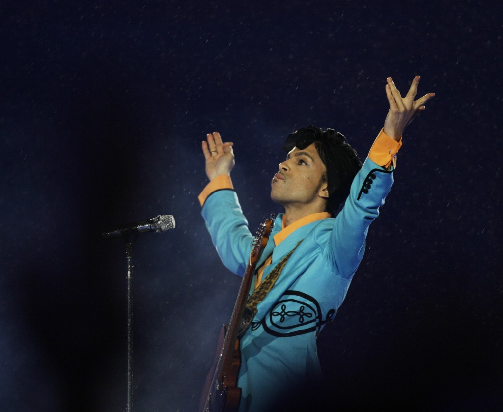 Prince photo: In this Feb. 4, 2007, file photo, Prince performs during the halftime show at Super Bowl XLI at Dolphin Stadium in Miami. In an industry where collaborations with other artists and credits are negotiated as heavily as world treaties, Prince followed only one credo when it came to working with others: the love of the music. Prince died Thursday, April 21, 2016, at his home outside Minneapolis. (AP Photo/Alex Brandon, File)