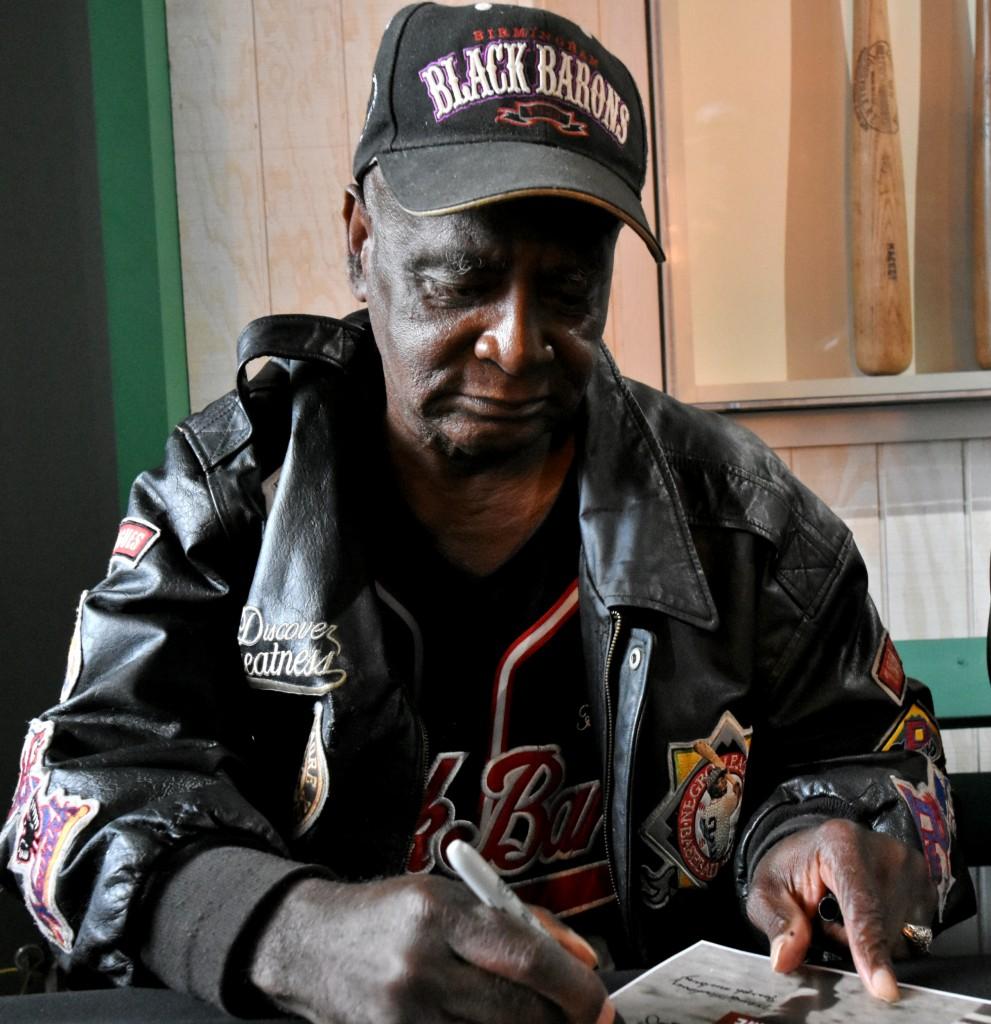 Former Birmingham Black Baron Henry Elmore signs autographs. (Solomon Crenshaw Jr. photo).