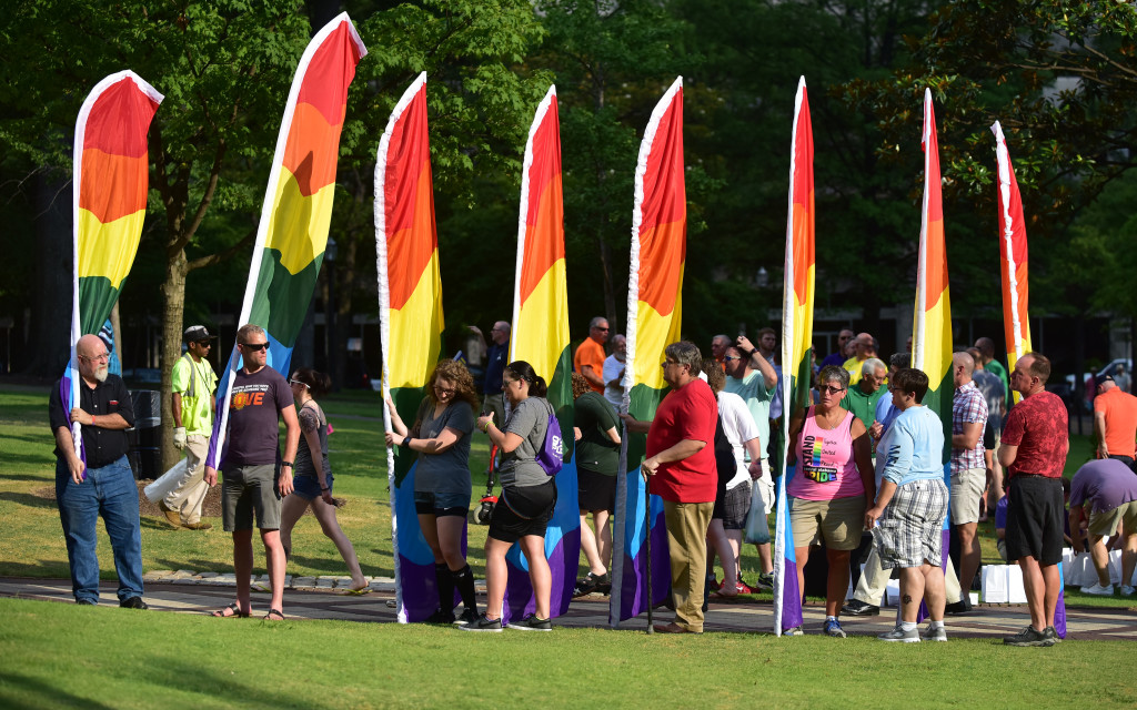 Flag bearers line up in Linn Park as the ceremony begins. Central Alabama Pride held a remembrance and candle light vigil for those killed and injured in an Orlando, Florida nightclub. The names of the victims were read aloud on the steps of the Jefferson County Courthouse and a rainbow banner was draped over the Birmingham City Hall entrance.  (Frank Couch / The Birmingham Times)