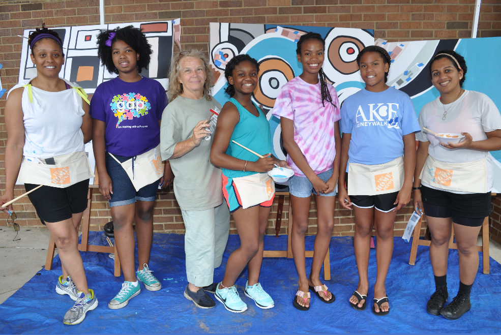From left: Lawanda Baker, artist: Drew Christen, a student at Phillips Academy, Janice Cook, a retired art teacher; Laila Vaker, student at Thompson Middle School; Angel Perterson, a student at Phillips Academy; Destiny Peterson, a student At Erwin Middle school and Somaya Singh, artist