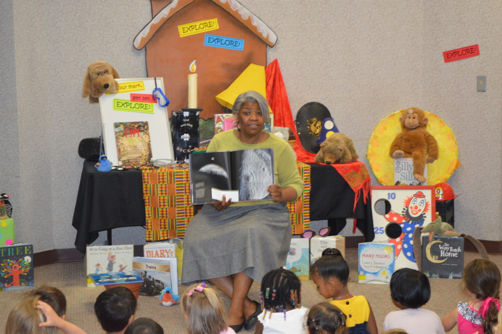 Cassandra Scott, aka Avondale Regional Library Storyteller Ms. Cas, reads to children during a program at Southside Library.