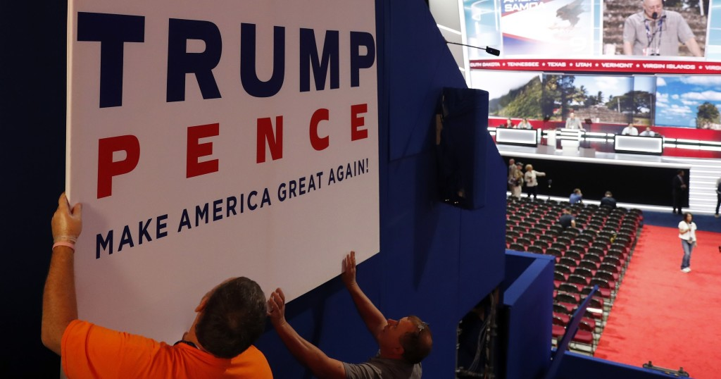 Workers place a sign as they prepare at Quicken Loans Arena for the Republican National Convention, Sunday, July 17, 2016, in Cleveland. (AP Photo/Carolyn Kaster