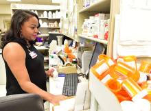 Amber Turner an Clinical Pharmacist checks a prescription she is filling in the Cooper Green Pharmacy. (Frank Couch / The Birmingham Times)