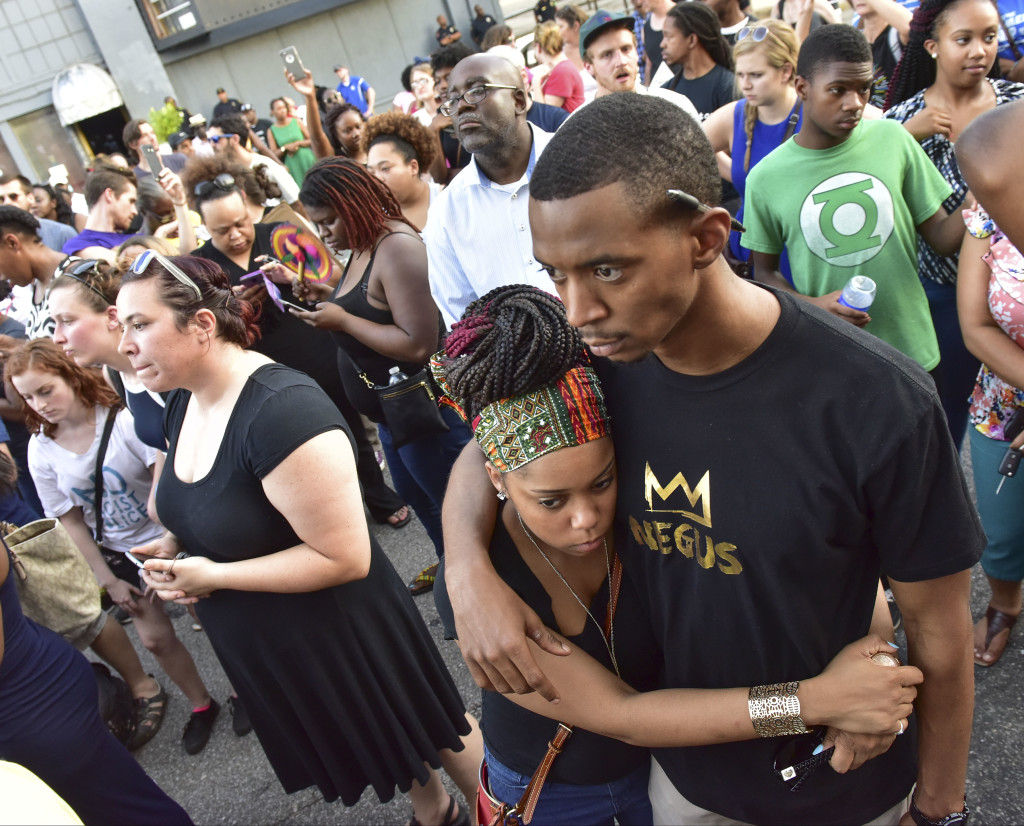 Brittany Powell hugs Brad Harper during a rally in front of Birmingham Police Headquarters. A solidarity protest and march held at Kelly Ingram Park saw hundreds of people listen to speakers, chant and march to Birmingham Police Headquarters. (Frank Couch / The Birmingham Times)