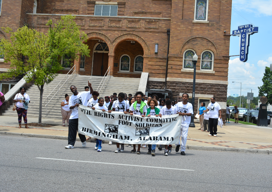 Camp participants re-enact the march of Foot Soldiers from the 16th Street Baptist Church in downtown Birmingham.
