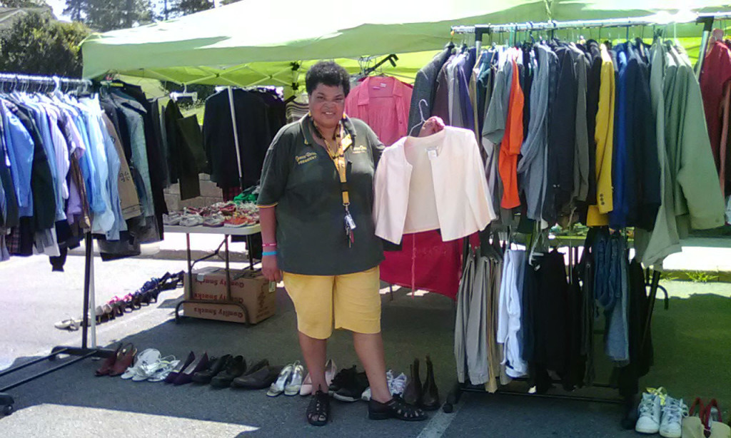 Geneva Brown, president of the Cooper Green Residents Council, collected clothes, organized them, and withstood 100-degree heat to operate a two-day pop-up boutique. Brown coordinated the free clothing giveaway for her neighbors. (Provided photos)