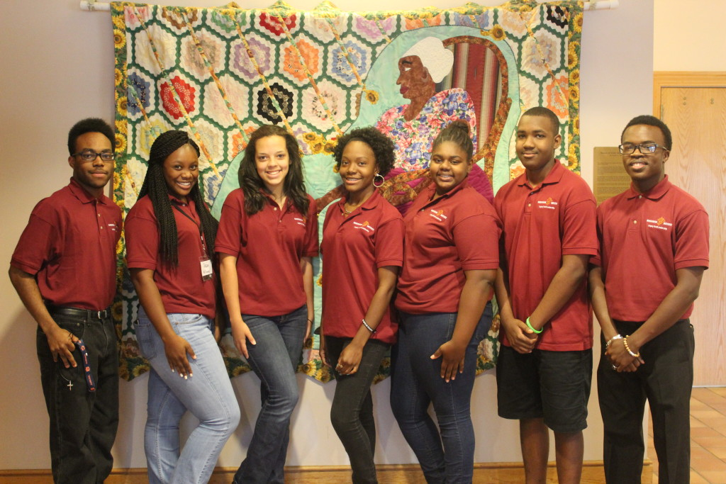 From left: Legacy alumni Chadwick Smith, Legacy students De'Ira Williams, Gabrielle Johnson, Jihaaya Muhammad, Amiya Whitson, Sam Pugh III, and Philip Green. Not pictured: Otis Smith, Jhynesis Gorman, Bianca Pittman, Patria Gatson, and Legacy alumni Lauryn Wedgeworth. (Ariel Worthy photo/The Birmingham Times).
