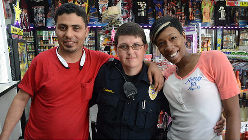 Officer Heather Campbell (center) with Waleed Senan, left, and Crystal Phillips at the Ensley Shell. (Karim Shamsi-Basha, Alabama NewsCenter)