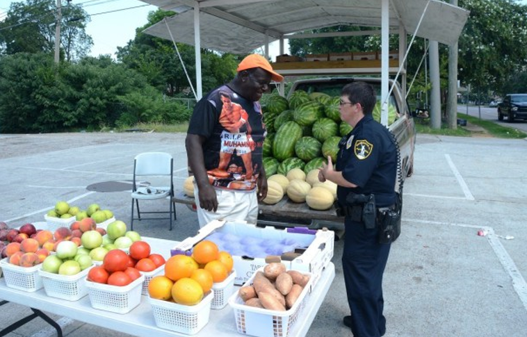Birmingham Police Officer Heather Campbell places a high priority on conversation with the people she serves. (Karim Shamsi-Basha, Alabama NewsCenter)