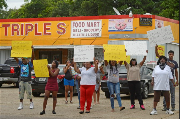Citizens protest after the police shooting of Alton Sterling, 37, in Baton Rouge. The shooting fueled anger in Baton Rouge, with hundreds protesting Tuesday night and demonstrations continuing Wednesday. (Associated Press)