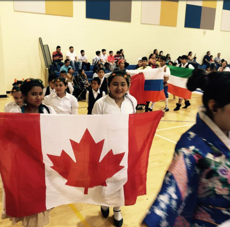 Native dances, songs and a parade of costumes from nearly 20 countries were on display as the English as a Second Language program concluded last month. (Chanda Temple photos).
