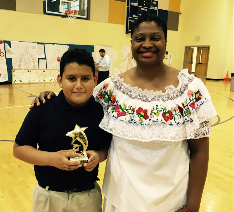 English as a Second Language student Jeffery Serrano with teacher Tamika Lamb. Jeffery received an award for Most Improved in Math. (Photo by Chanda Temple).