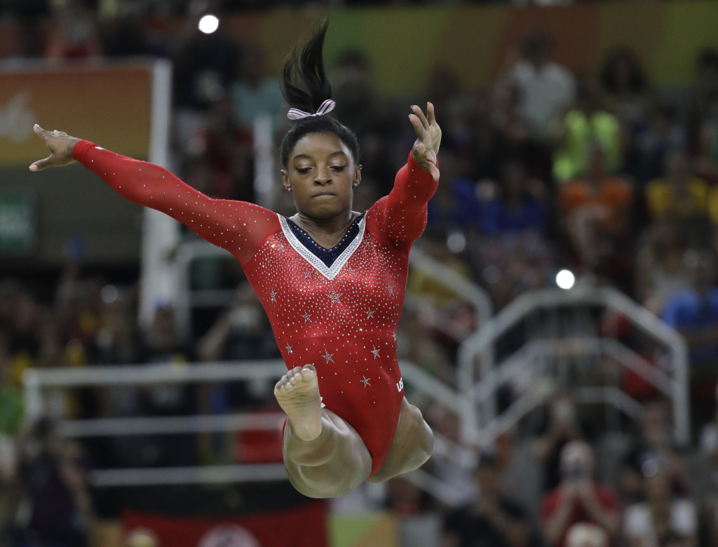 United States' Simone Biles performs on the balance beam during the artistic gymnastics women's apparatus final at the 2016 Summer Olympics in Rio de Janeiro, Brazil, Monday, Aug. 15, 2016. (Julio Cortez, The Associated Press)