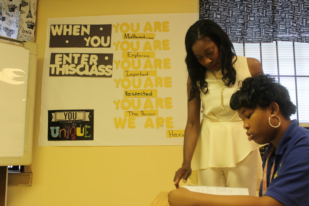 Dukes helps student Breanna Ward, 16, study for an assignment. Maranathan Academy is for critically at-risk students in the Birmingham and its surrounding areas. (Ariel Worthy, The Birmingham Times)