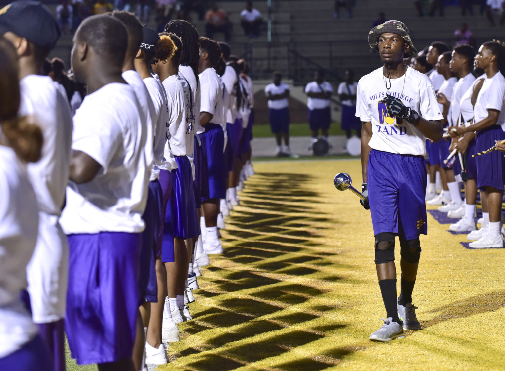 Head Drum Major Justin Mims helps line up band members in a recent Miles College Purple Marching Machine Band practice in Fairfield. (Frank Couch photos, The Birmingham Times)
