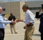 President Barack Obama reaches to shake hands with Louisiana Gov. John Bel Edwards, after arriving on Air Force One at Baton Rouge Metropolitan Airport in Baton Rouge, La., Tuesday, Aug. 23, 2016. Obama is traveling to the area to survey the flood damage. (Susan Walsh, Associated Press)