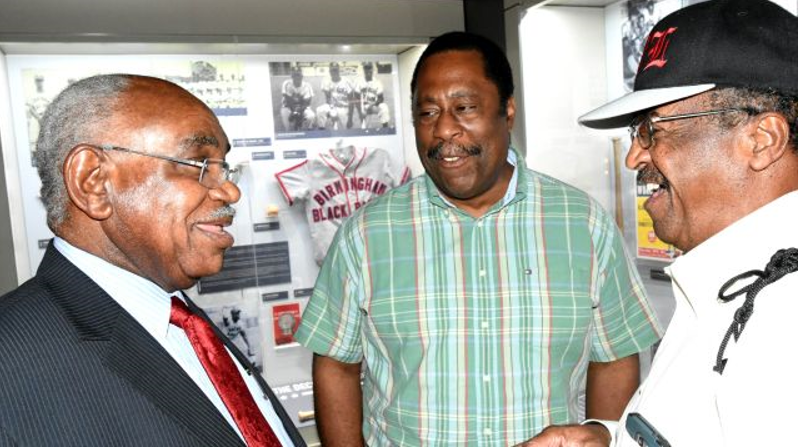 U.W. Clemon, left, speaks with other guests at the Negro Southern League Museum. (Solomon Crenshaw Jr. photos, Alabama NewsCenter).