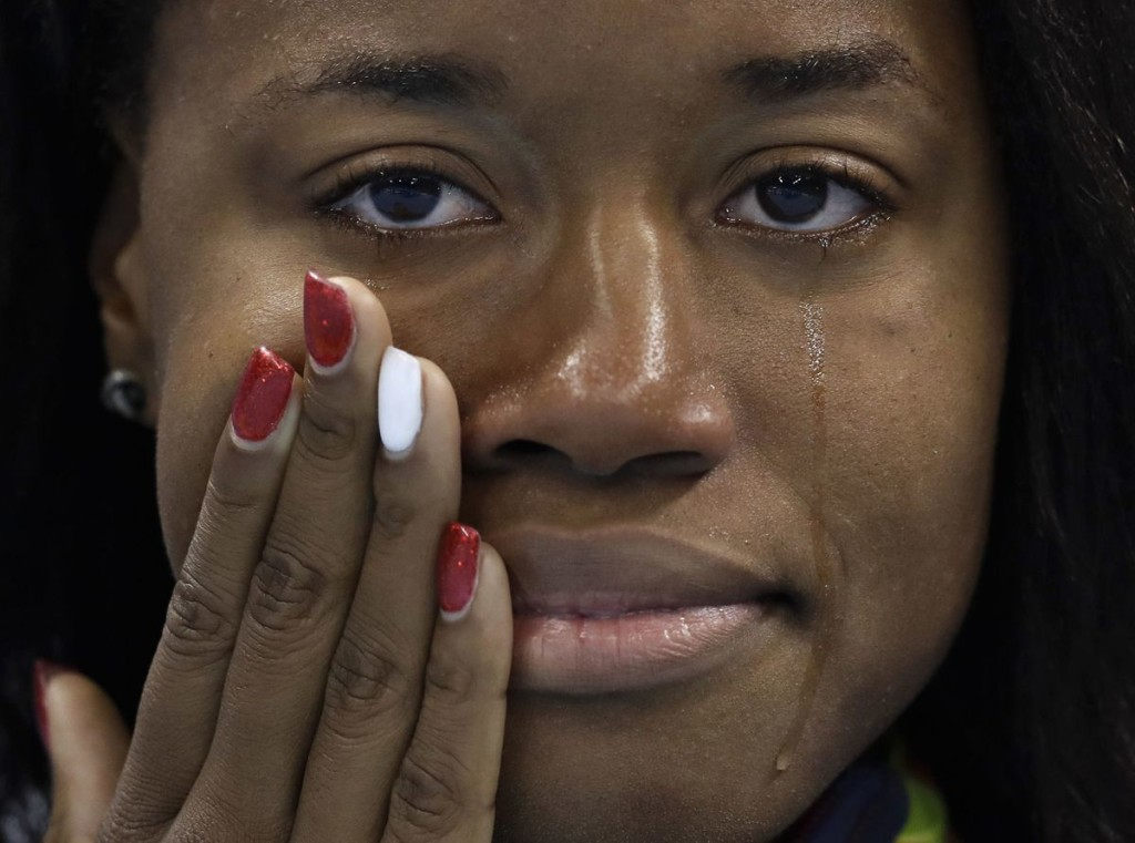 United States' gold medal winner Simone Manuel cries during the medal ceremony for the women's 100-meter freestyle final during the swimming competitions at the 206 Summer Olympics, Aug. 12, in Rio de Janeiro, Brazil. (Michael Sohn, The Associated Press)
