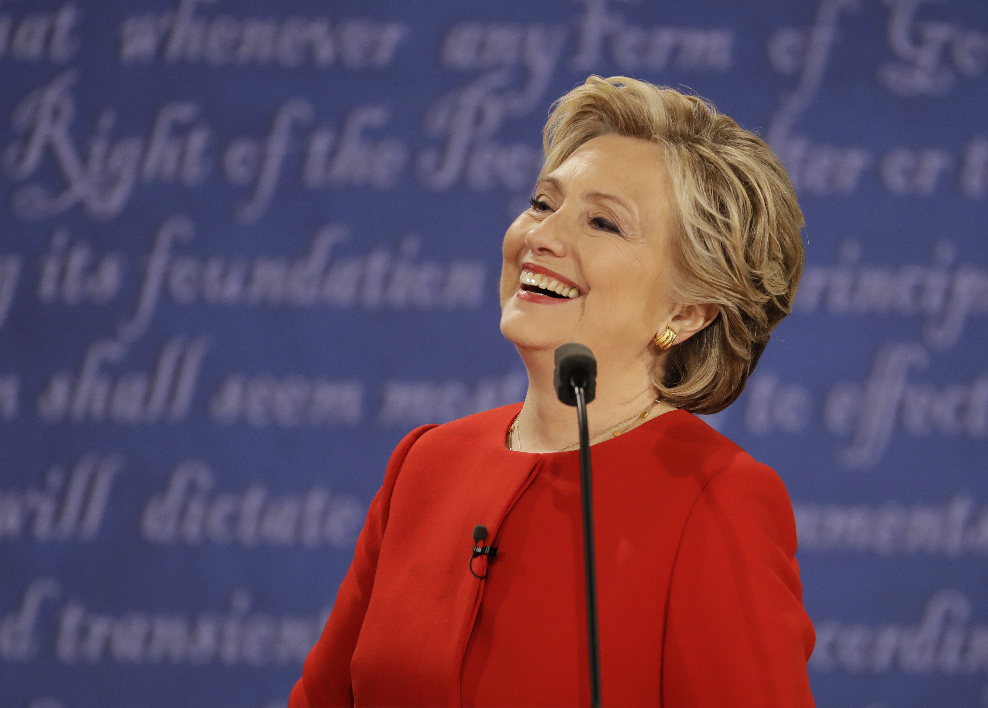 Democratic presidential nominee Hillary Clinton laughs to Republican presidential nominee Donald Trump during the presidential debate at Hofstra University in Hempstead, N.Y., Monday, Sept. 26, 2016. (Julio Cortez, Associated Press)