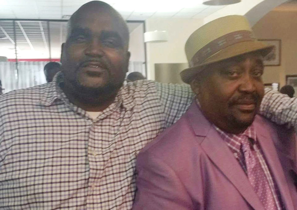 This undated photo provided by the Parks & Crump, LLC shows Terence Crutcher, left, with his father, Joey Crutcher. Crutcher, an unarmed black man was killed by a white Oklahoma officer Friday, Sept. 16, 2016, who was responding to a stalled vehicle. (Courtesy of Crutcher Family/Parks &; Crump, LLC via AP)
