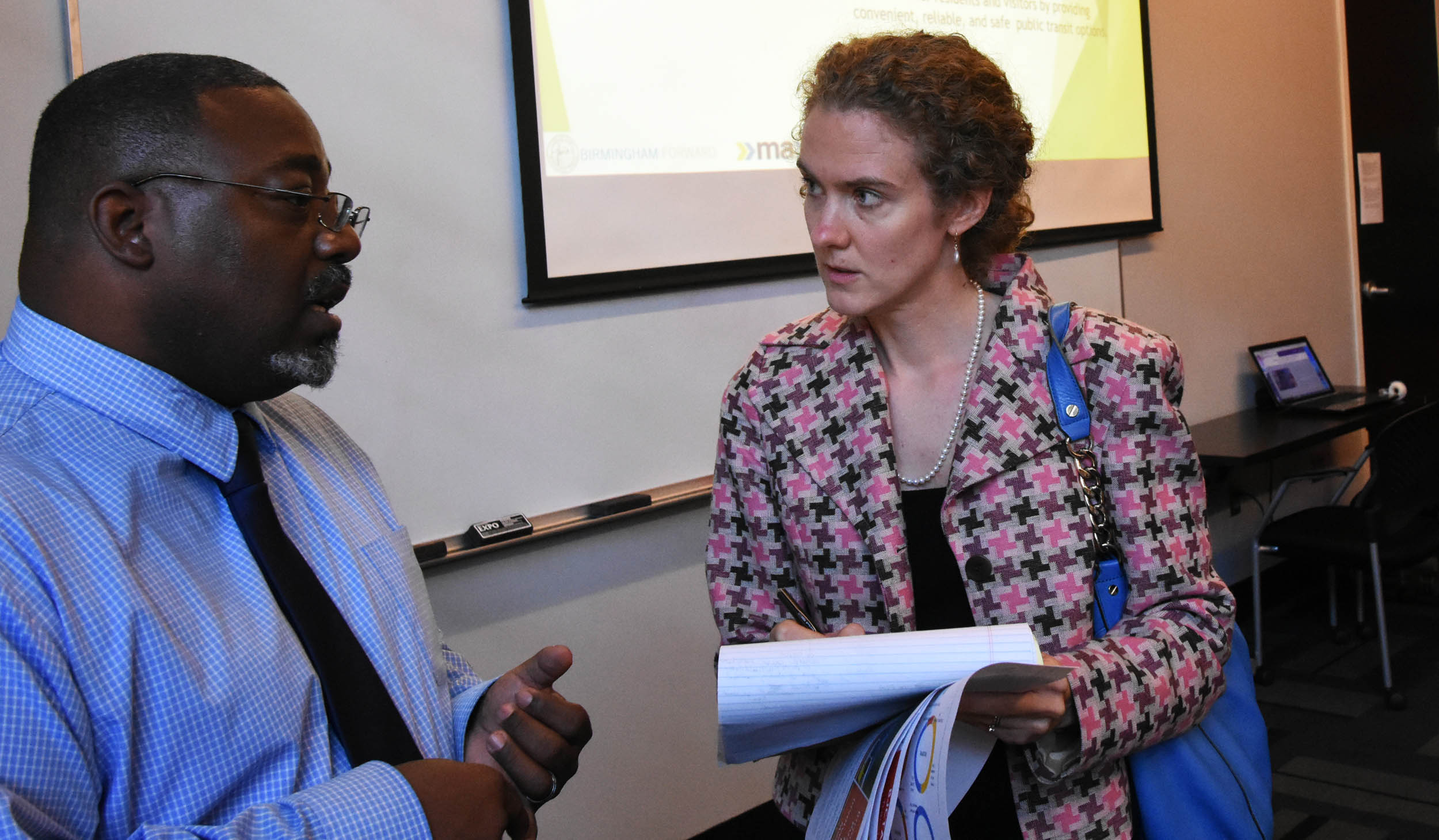 Darrell Howard talks with Sarah Stokes of Southern Environmental Law Center. (Solomon Crenshaw Jr., special to The Times)