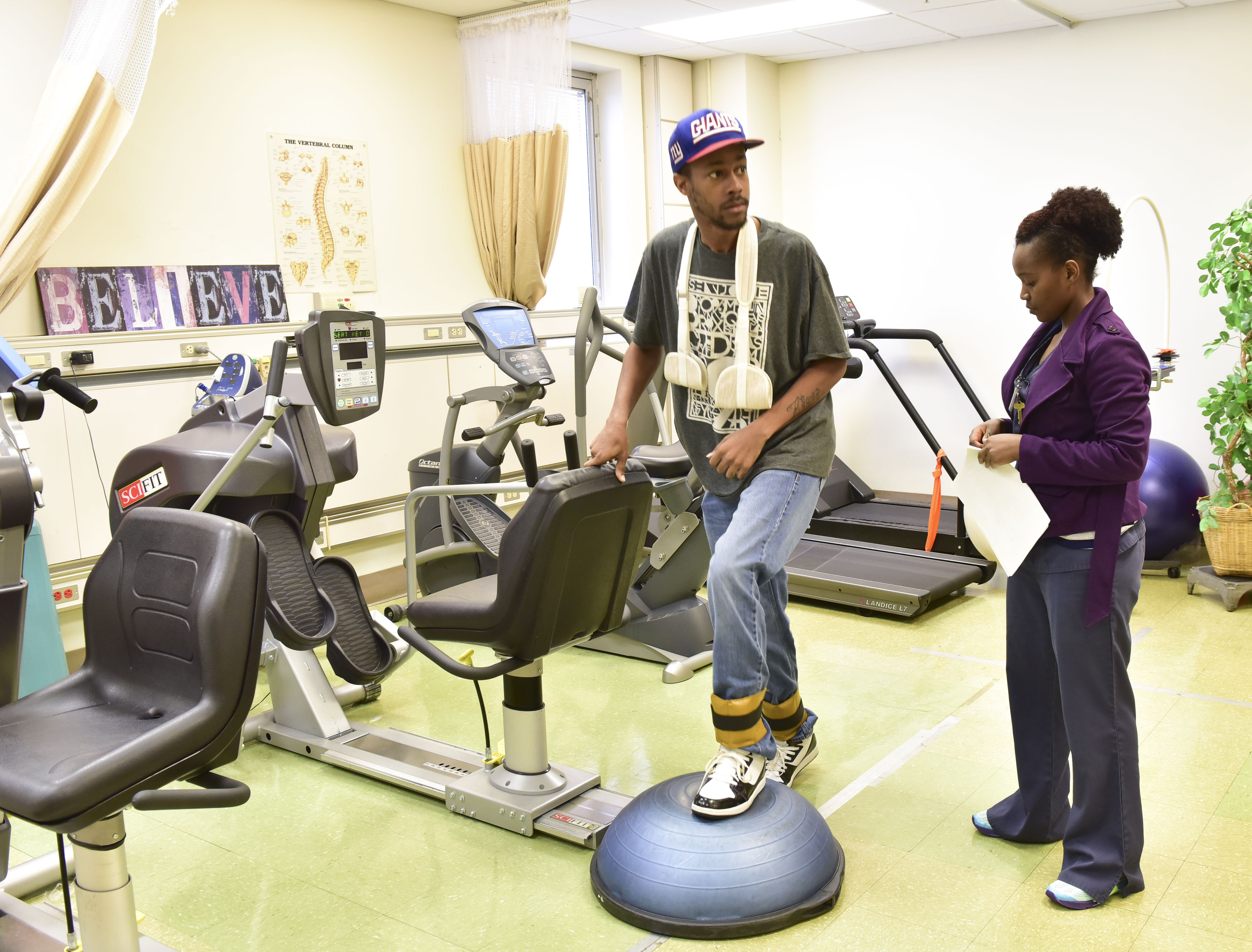 Ronald Mayfield was involved in a motorcycle accident and is going through physical therapy at Cooper Green with Lilian Waweru, P.T.A. (physical therapy assistant). (Frank Couch, The Birmingham Times)