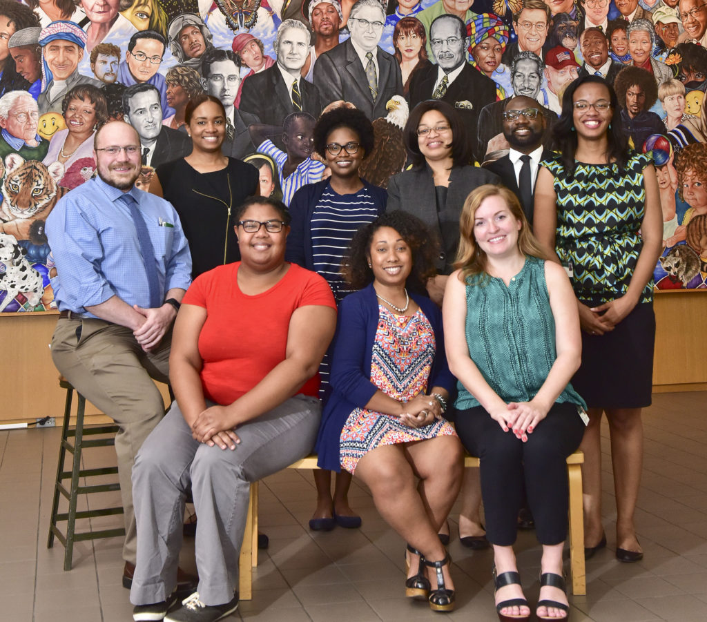 Young professional board members met at Sept. 20 at the Birmingham Public Library. Board members, bottom row from left, Latasha Watters, Tevis Owens and Leah Bigbee. Back row, seated, Eric Martin Scott, Alexis Barton, Tiffanie Jeter, Sebrina Stoutemire, James Sullivan and Kamina Perdue. (Frank Couch, for The Birmingham Times)