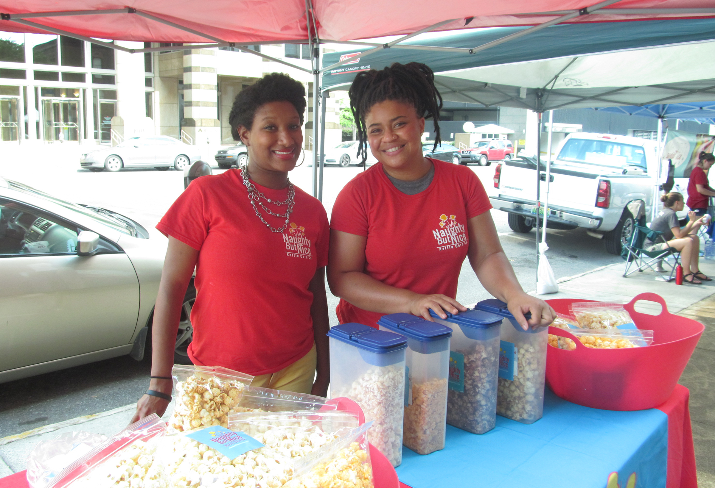 Tanesha Sims-Summers and Tiffany Turner went through the CO.STARTERS program when they began their company, Naughty But Nice A Kettle Corn Co. two years ago. The duo sell their flavored kettle corn at farmers' markets throughout the city. (Kathryn Sesser-Dorné, special to The Times)