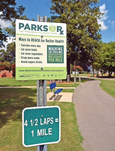 A Parks Rx sign hangs is shown at the West End Walking Trail. Similar signs will be installed in all Birmingham parks. (Mark Almond, special to the Times)