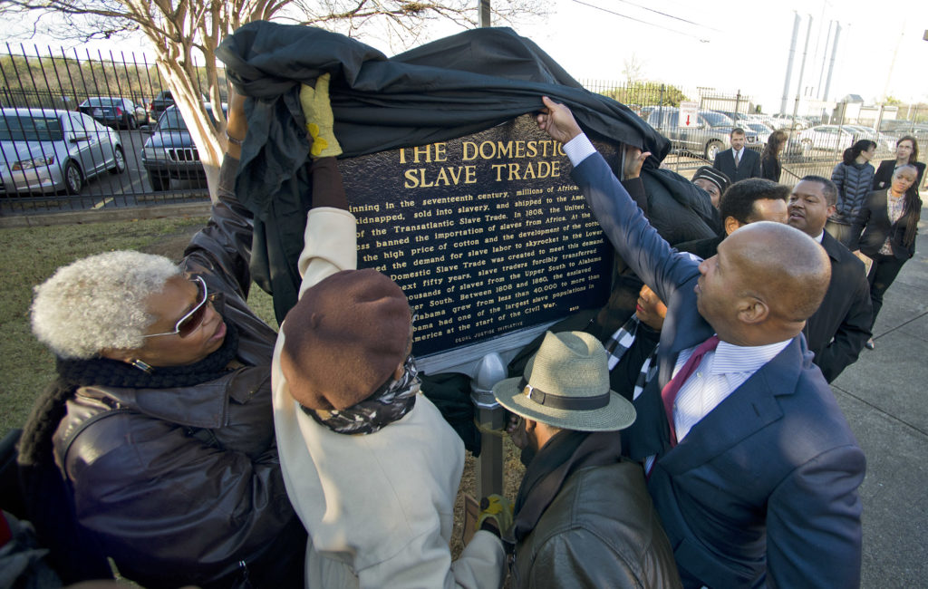 Bryan Stephenson, founder and executive director of the Montgomery-based Equal Justice Initiative, right, helps unveil a historical marker honoring the Domestic Slave Trade. (Bernard Troncale,special to The Times)