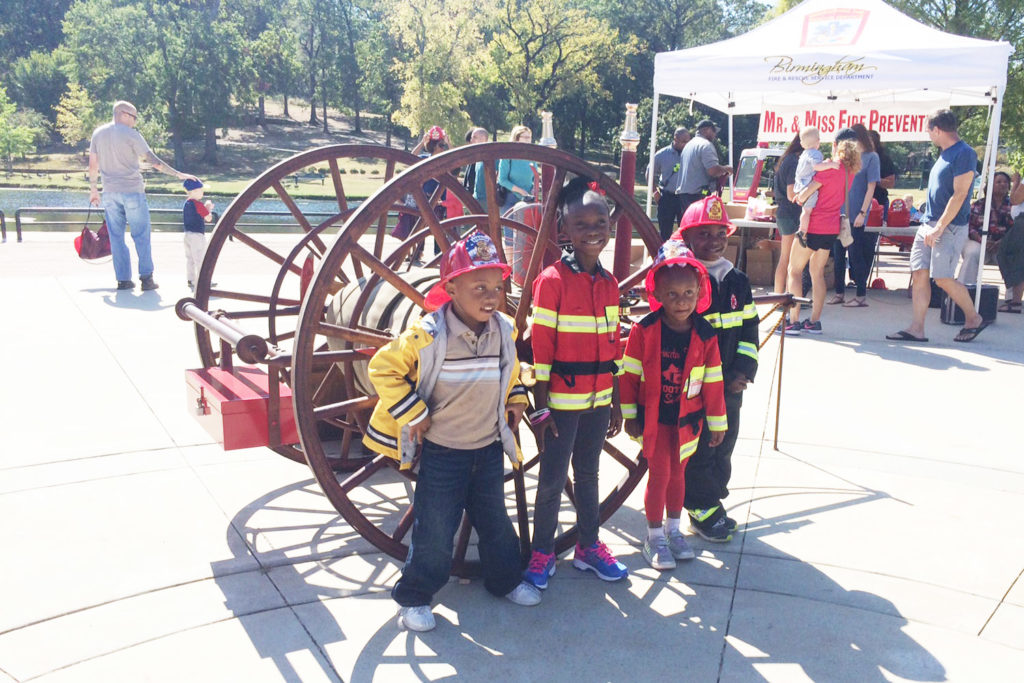 Children dressed as firefighters take part in the Second Annual Fire Department Expo.