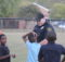 A Birmingham City Police officer interacts with children in the Gate City area. (Ariel Worthy, The Birmingham Times)