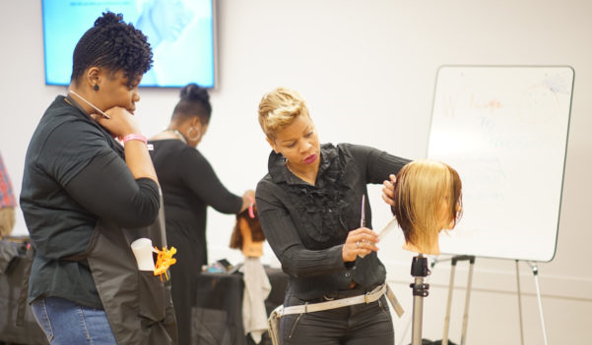 Evie Johnson demonstrates one of her haircutting techniques. (Arisha Hawkins, Courtesy photo)