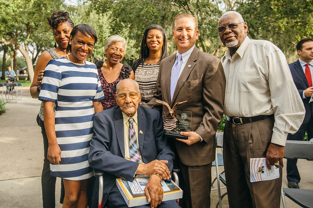 "St. Petersburg, Fla hosted the second annual Veterans Day Celebration on Wednesday, November 11, 2015 in Williams Park. Willie Rogers (center) was presented with the""2015 Honored Veteran"" Award for his service as a Master Sergeant with the famed Tuskegee Airmen during World War II. (The City of St. Petersburg/Flickr Creative Commons)"