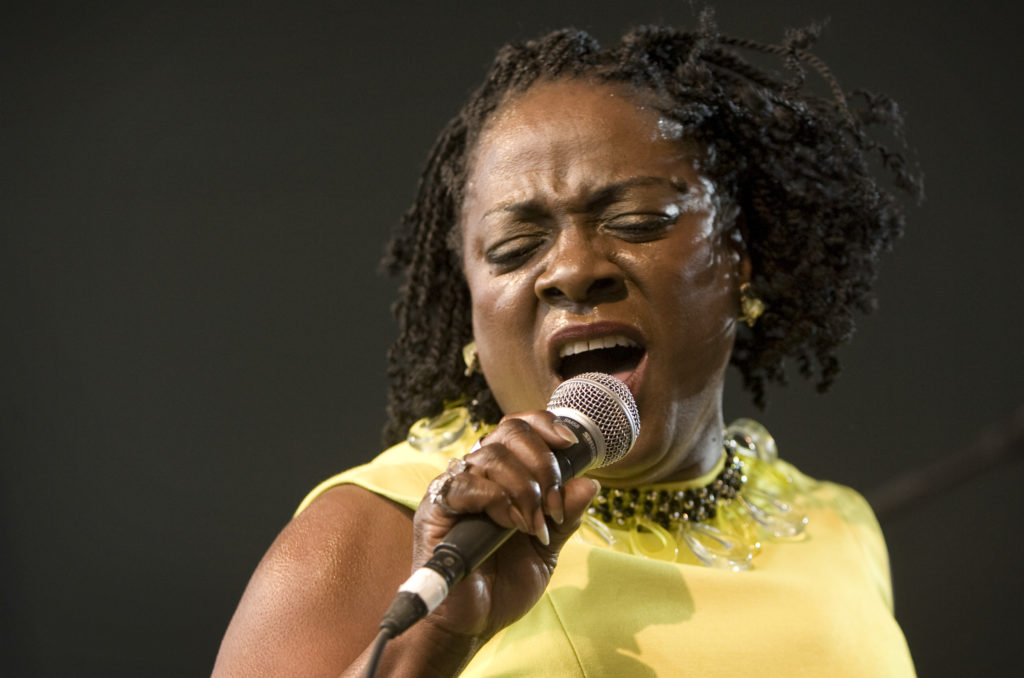 In this March 19, 2010 file photo, Sharon Jones and the Dap-Kings perform at the SPIN Party at Stubb's during the South by Southwest music festival in Austin, Texas. Jones, a big-voiced soul singer who performed with high energy onstage has died at age 60 in New York, after battling pancreatic cancer. Her representative Judy Miller Silverman says she died Friday, Nov. 18, 2016, at a Cooperstown hospital surrounded by her band, the Dap-Kings. (Jay Janner/Austin American-Statesman via AP, File)