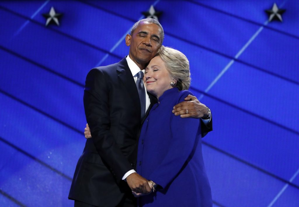 Democratic presidential nominee gets a hug from President Barack Obama during the Democratic National Convention. (AP Photo/J. Scott Applewhite)