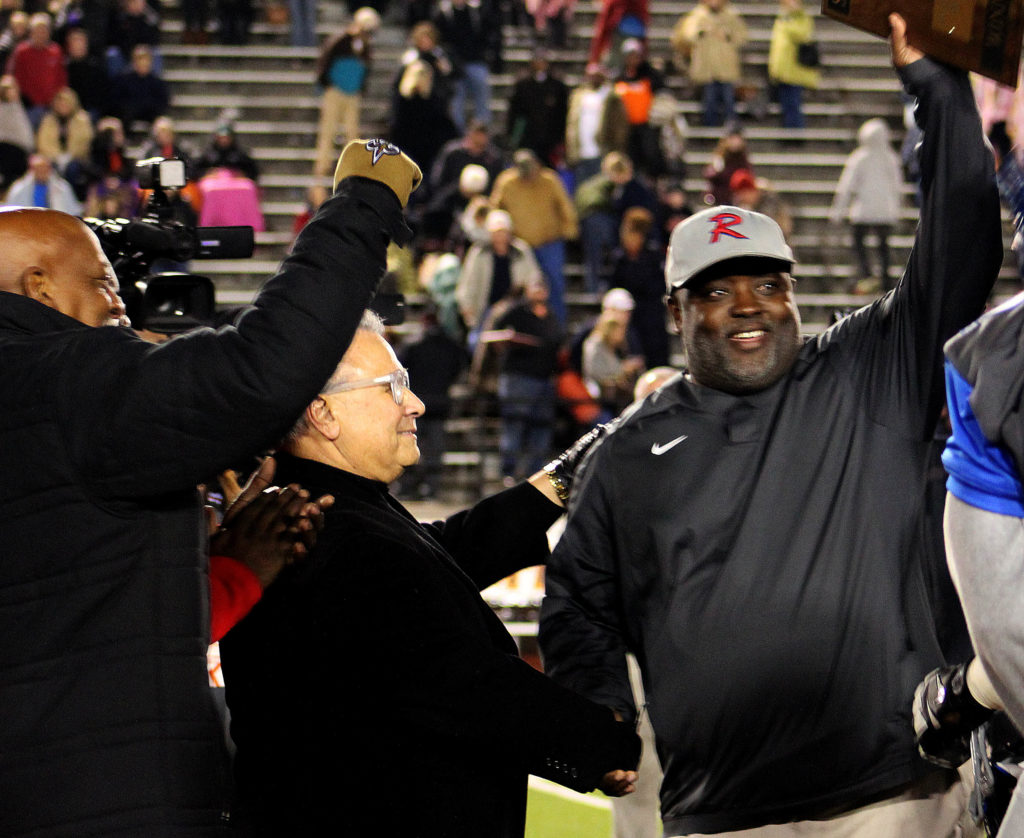 State Sen. Rodger Smitherman, D-Birmingham, and interim Birmingham School Superintendent Larry Contri congratulate Ramsay coach Reuben Nelson after his Rams beat Austin 24-14 to win their Class 6A Alabama High School Athletic Association semifinal on Friday, Nov. 25, 2016. Ramsay joins Wenonah as the first two Birmingham City Schools to advance to state football championship games in the same post season. (Fransetta Henry, special to The Birmingham Times)