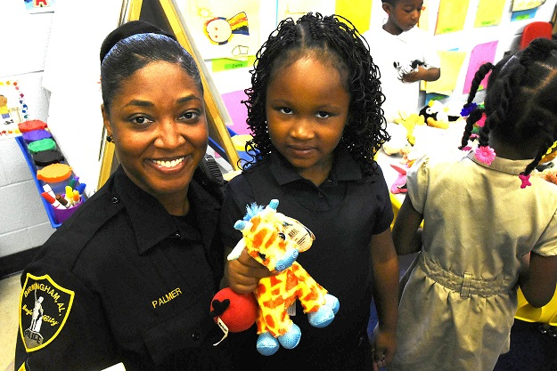 Sergeant Reva Palmer shares a smile with Valencia Dowdell. The Birmingham Police Department (BPD) is part of a select group of pilot cities participating in the National Initiative for Building Community Trust and Justice. (Solomon Crenshaw Jr., special to The Times)