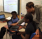 An instructor at Green Acres works with students with a set of laptops being used in class. A new grant will now help the school buy laptops for every class. (Chanda Temple, provided photos)