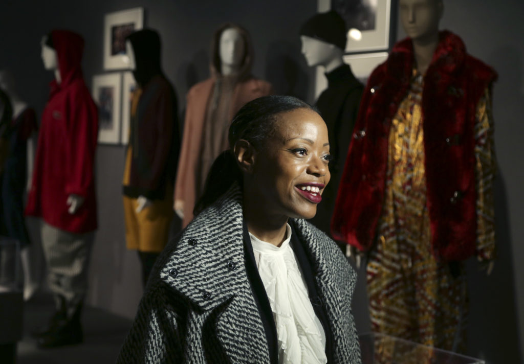 "Designer Tracy Reese speaks to a reporter at the opening of the ""Black Fashion Designers"" exhibit at the Fashion Institute of Technology in New York, Tuesday, Dec. 6, 2016. (Seth Wenig, Associated Press)"