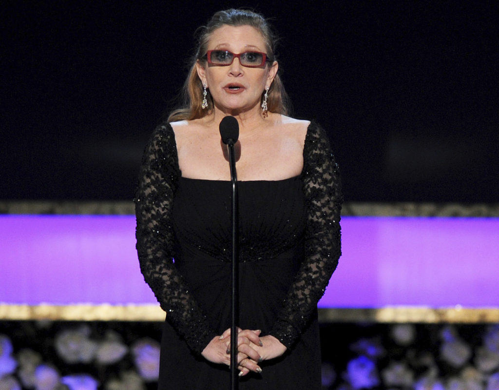 In this Sunday, Jan. 25, 2015 file photo, Carrie Fisher presents the life achievement award on stage at the 21st annual Screen Actors Guild Awards at the Shrine Auditorium in Los Angeles. (Vince Bucci/Invision/AP, File)